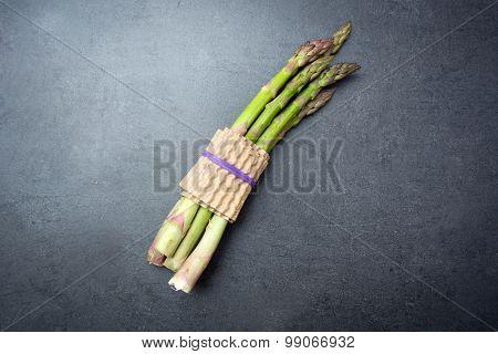 Green asparagus on slate
