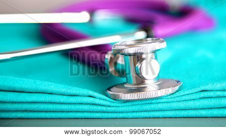Medical stethoscope rests on a uniform close-up