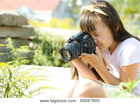 Girl Taking Picture On Natural