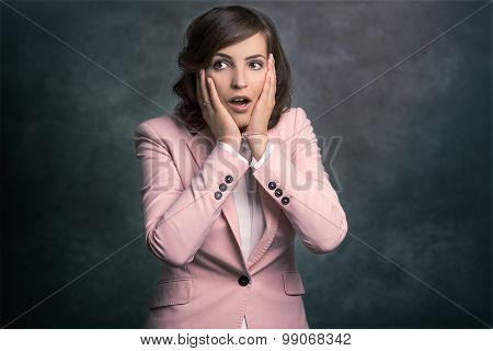 Young Woman Reacting In Shock And Horror