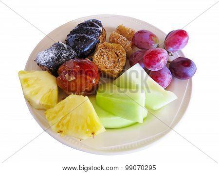 Dessert On Dish Cakes, Melon, Pineapple, Grape Isolated Over White