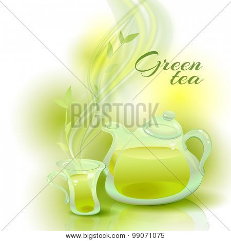 Transparent glass teapot and a cup with green tea.