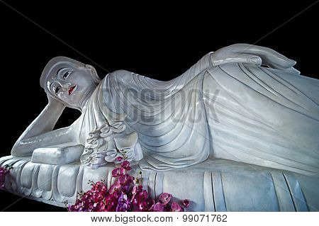 reclining buddha statue on black background