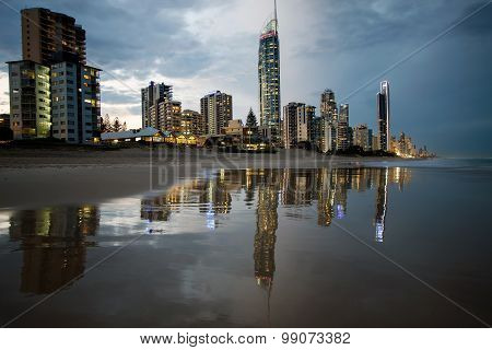 Reflection of apartments in at beach