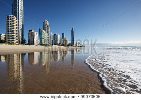 Reflection of apartments in sea at sunrise, Gold Coast, Australia
