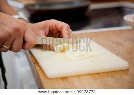 Woman Slicing Onions