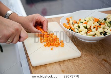 Woman Slicing Carrots