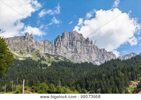 Mountains With Steep Cliffs In Alps