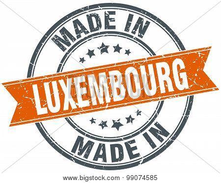 Luxembourg Orange Grunge Ribbon Stamp On White