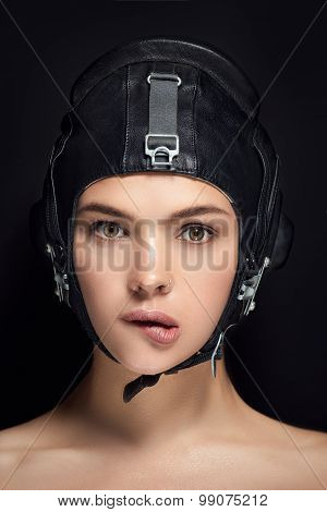 Woman in black helmet and professional makeup close up portrait