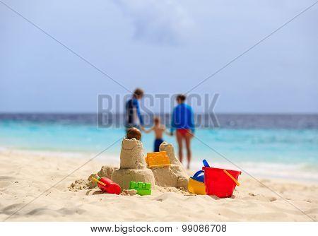 sand castle and toys on tropical beach