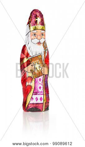 Close up of Sinterklaas. Saint  Nicholas chocolate figure of  Dutch character of Santa Claus. Isolated on white background with reflection