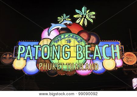 Patong Beach welcome sign illuminated above entrance to Bangla Road