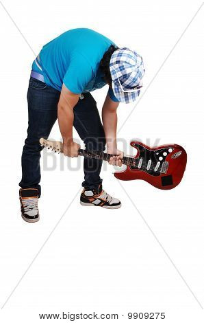 Boy Mad At The Guitar.