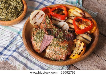 Veal Meat And Grilled Vegetables With Pesto Sauce Close-up. Horizontal