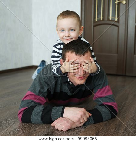 boy father lying on the floor at home