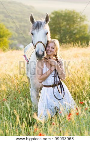 Young woman with horse outdoor
