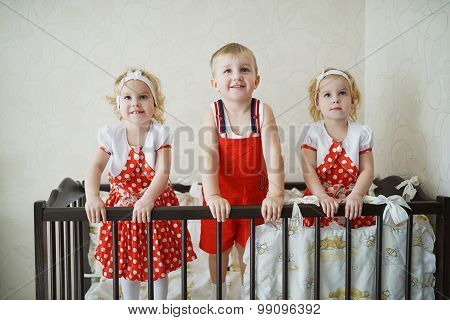 boy with two girls twins
