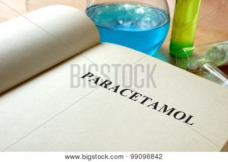 Paper with paracetamol and test tubes.