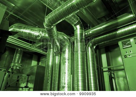 Ventilation Pipes Of An Air Condition In Green Tones