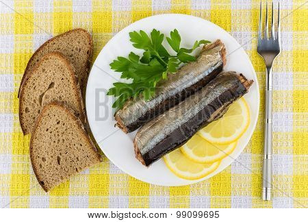 Canned Fish, Lemon, Parsley In Plate And Pieces Of Bread