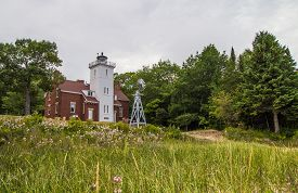 stock photo of mile  - The Forty Mile Point Lighthouse was completed in 1896  and is on the Lake Huron coast - JPG