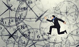foto of running-late  - Concept of time with funny businessman running in a hurry - JPG
