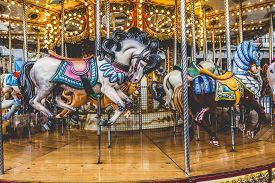 stock photo of carousel horse  - Old French carousel in a holiday park - JPG