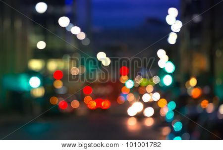 City lights blur background. London, Canary Wharf night life. Traffic, roads, lanterns and lit up of