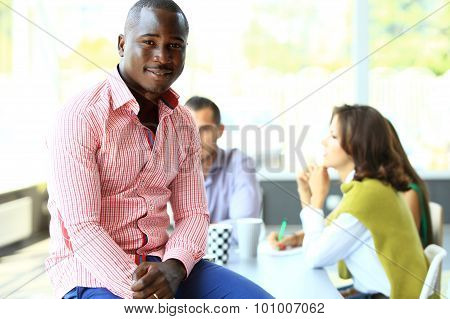 Portrait Of Smiling African American Business Man With Executive