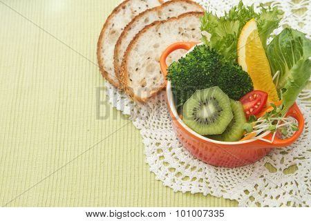 Fusion Food, Fruit And Vegetable Salad In Colorful Cup With Whole Wheat Bread