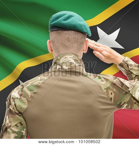 National Military Forces With Flag On Background Conceptual Series - Saint Kitts And Nevis