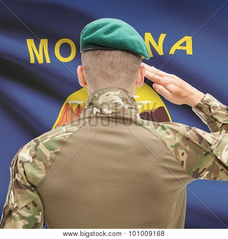 Soldier Saluting To Usa State Flag Conceptual Series - Montana