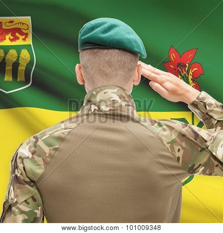 Soldier Saluting To Canadial Province Flag Conceptual Series - Saskatchewan