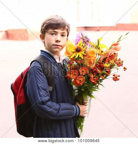 Boy With Flowers At The First Of September School Day