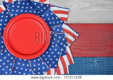 High angle shot of American Flag napkins on a red, white and blue picnic table. Horizontal format with copy space. Suitable for American Holidays: 4th of July and Memorial Day, and Veterans Day.