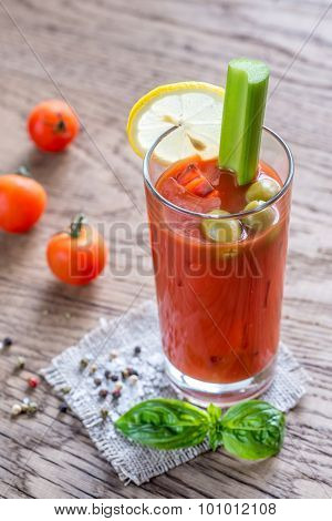Bloody Mary Cocktail On The Wooden Background