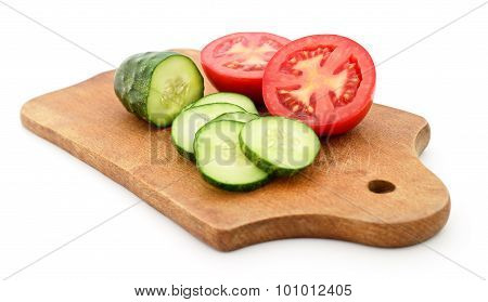 Tomato And Cucumber On The Board.