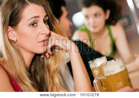 People in bar, woman being abandoned and sad
