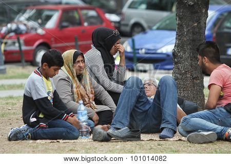 Refugees Resting On Ground In Belgrade