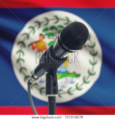Microphone On Stand With National Flag On Background - Belize