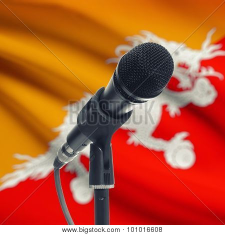 Microphone On Stand With National Flag On Background - Bhutan