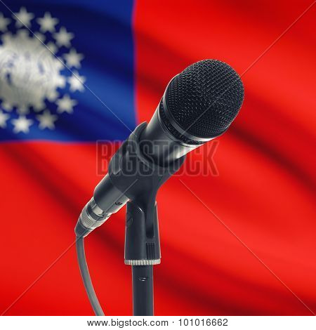 Microphone On Stand With National Flag On Background - Burma