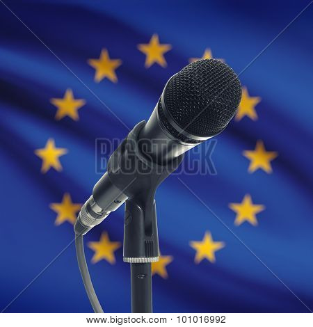 Microphone On Stand With National Flag On Background - European Union - Eu