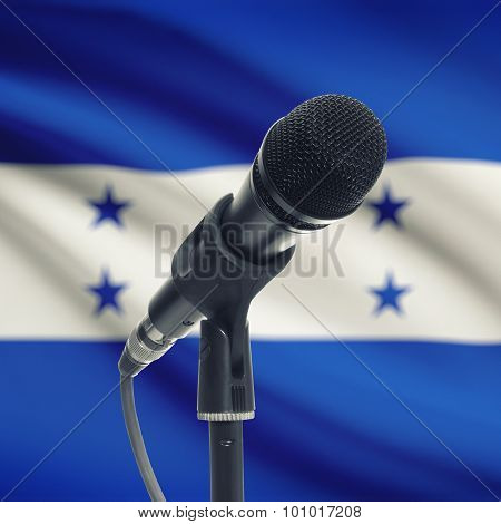 Microphone On Stand With National Flag On Background - Honduras