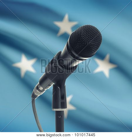 Microphone On Stand With National Flag On Background - Micronesia