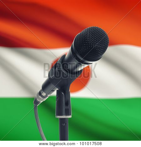 Microphone On Stand With National Flag On Background - Niger