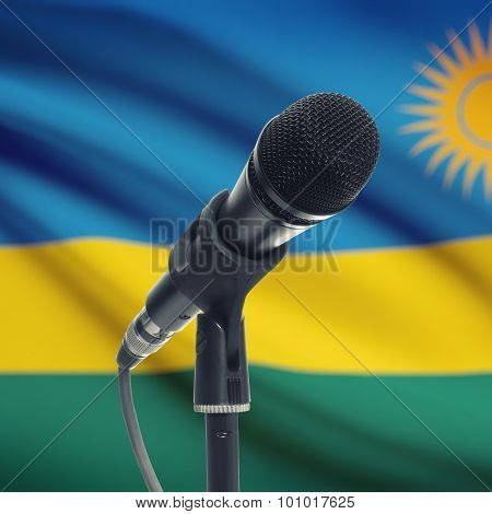 Microphone On Stand With National Flag On Background - Rwanda