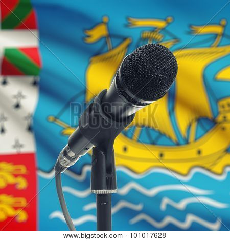 Microphone On Stand With National Flag On Background - Saint-pierre And Miquelon