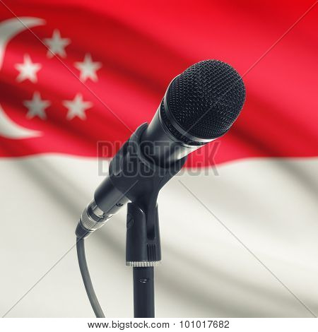 Microphone On Stand With National Flag On Background - Singapore